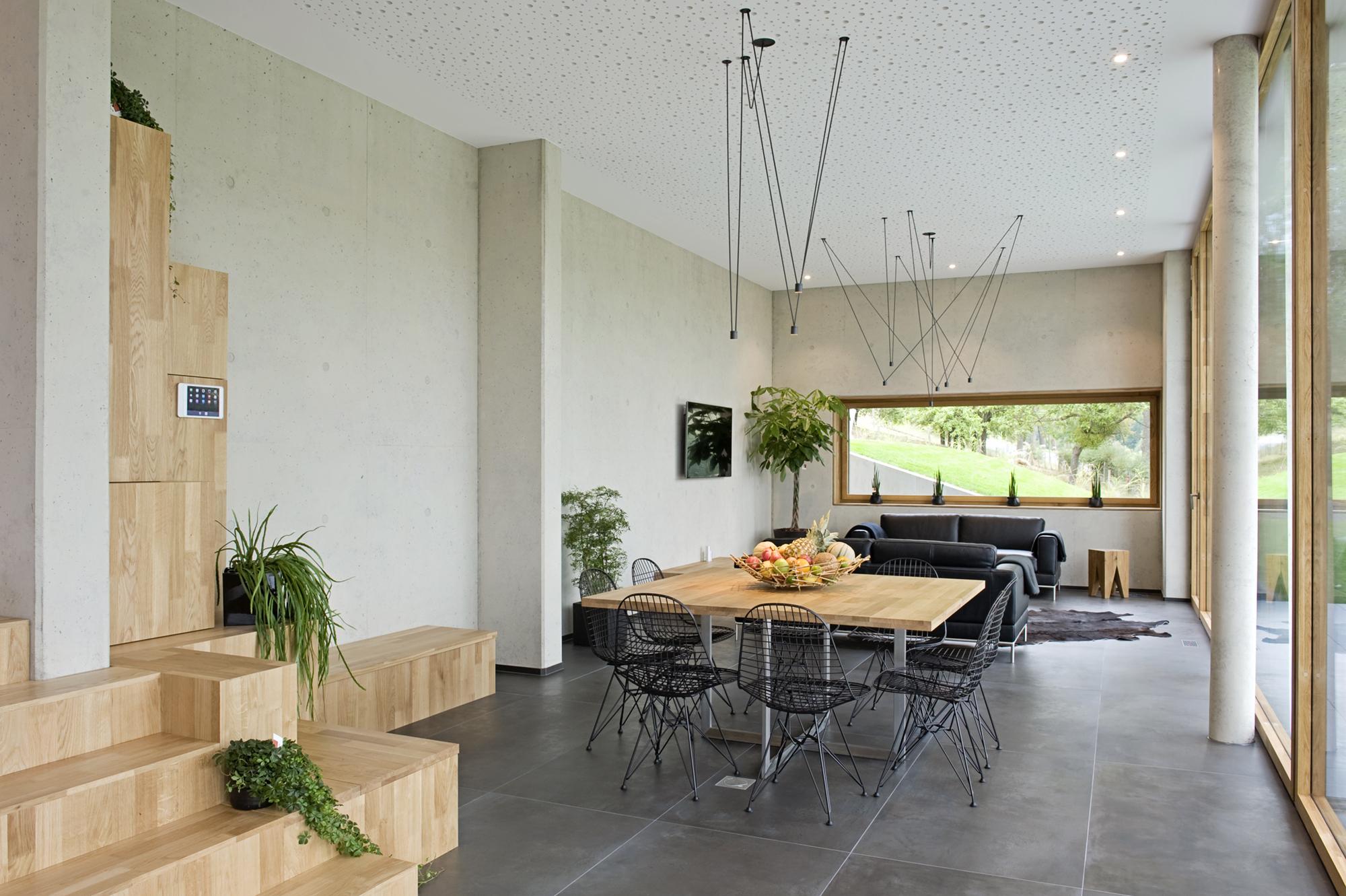 Maison unifamiliale hybride en béton et bois massif ...